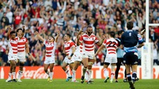 Japan's players celebrate their shock victory over two-times World Champions South Africa