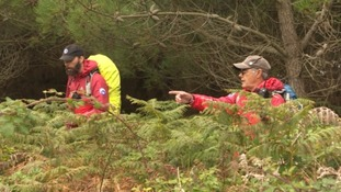 Cornwall Search & Rescue Team looking in undergrowth on Tresco