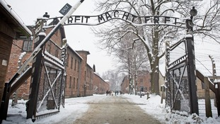 Prosecutors say the woman was a member of the Nazi SS.