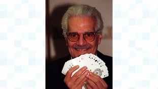 Bridge-playing film star Omar Sharif shows his hand