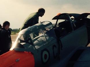 The Prince climbs into the cockpit