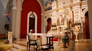 Pope Francis prays inside the sanctuary of the Virgin of Charity in El Cobre, Cuba.