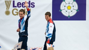 Alistair (left) and Jonathan Brownlee celebrate with their medals during a homecoming reception in Millennium Square, Leeds.
