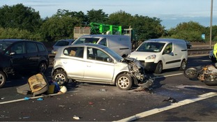 Motorcyclist trapped under car in horror M6 crash