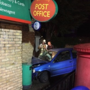 Car crashes into Woodcote post office.