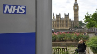 NHS with House of Commons in the background