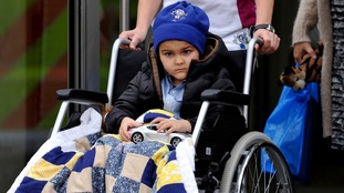 Ashya King, 5, leaves after treatment at the clinic in Prague.