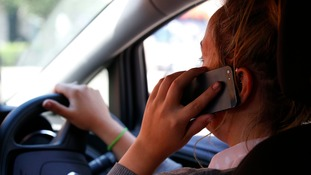 Driver on their mobile phone (library pic)
