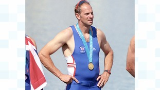 Sir Steve Redgrave gets his gold medal at the Sydney Olympics