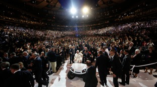 Pope Francis is driven on a golf cart as he arrives at Madison Square Garden