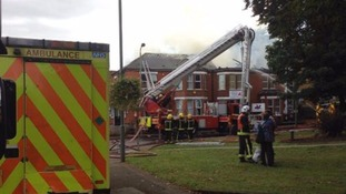Two people taken to hospital after large fire at vets
