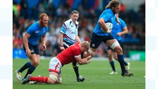 Italy's Josh Furno is tackled by Canada's John Moonlight (left) during the Rugby World Cup match at Elland Road, Leeds.
