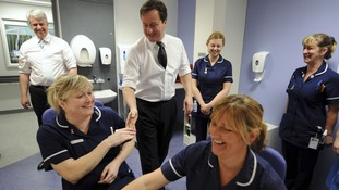 David Cameron and Andrew Lansley talking to nurses