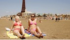 Two beach-goers enjoying the sun in Blackpool