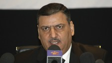 efected Syrian Prime Minister Riyad Hijab speaks during a news conference in Amman