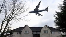 plane over houses at heathrow