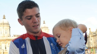Luke Campbell and his son Leo celebrate with his boxing gold medal during an Olympic homecoming in Queen Victoria Square, Hull.