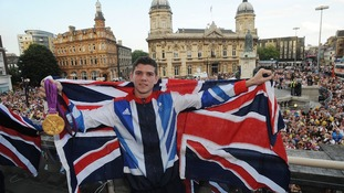 Luke Campbell celebrates with his boxing gold medal during a homecoming in Queen Victoria Square, Hull.