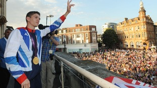 Luke Campbell celebrates with his boxing gold medal during an Olympic homecoming in Queen Victoria Square, Hull.