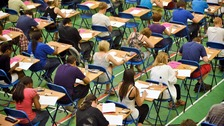 File photo dated 24/05/10 of A-level students sitting an exam. 