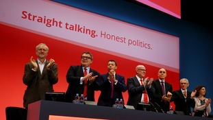 Labour party leader Jeremy Corbyn (left) with his deputy Tom Watson (second left) and Labour delegates