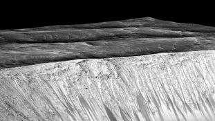 ark narrow streaks called recurring slope lineae emanating out of the walls of Garni crater on Mars.