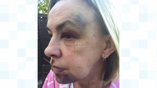 Woman punched to the ground in her own home by bogus charity collector