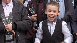 Bailey Matthews celebrates Pride of Britain award at Downing Street