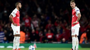 Theo Walcott (left) Mesut Ozil (right) dejected at the restart after conceding their third goal during the UEFA Champions League, Group F match at The Emirates Stadium