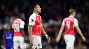 Alexis Sanchez (left) dejected during the UEFA Champions League, Group F match at The Emirates Stadium