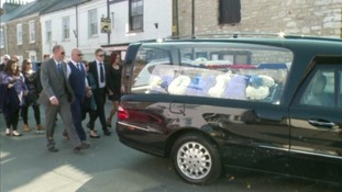 People followed the hearse to the church