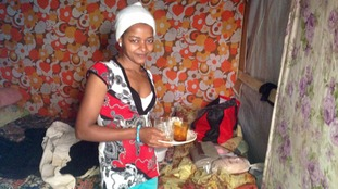 A woman makes tea for us shortly after our arrival in the camp