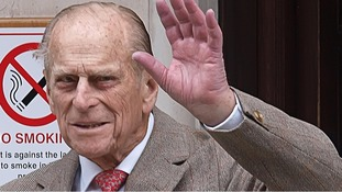 The Duke of Edinburgh waves as he leaves King Edward VII Hospital in central London after being treated for a bladder infection.