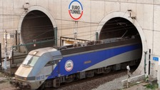Eurotunnel suspended after 'massive invasion'.