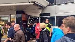 Two people killed after bus crashes into supermarket