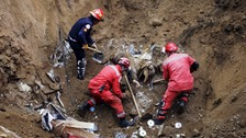 Rescue workers look for survivors