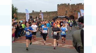 The runners set off from Carlisle Castle.