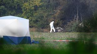 air investigators at crash site