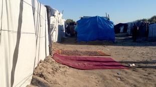 Prayer mas lie outside a makeshift shelter