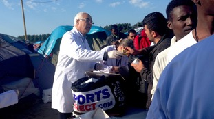 A queue forms as medicine is handed out at the camp
