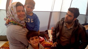 Evan and Aram walked for six hours carrying their children on their journey to northern France
