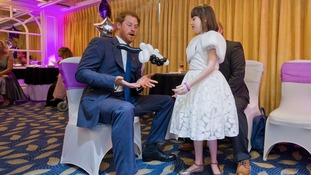 HRH Prince Harry plays balloon tennis with Nellie-Mai