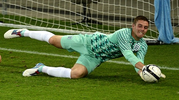 England goalkeeper Jack Butland makes a save on his debut during the International Challenge match at Wankdorf Stadium,