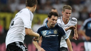 Germany's Lars Bender (right) moves in to try to stop Lionel Messi in his tracks.