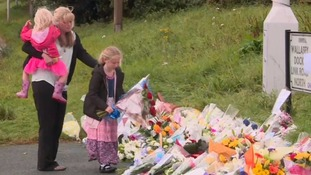 Family lay flowers at scene of PC's hit-and-run death