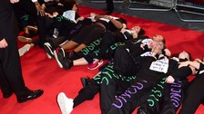 Protesters laid down on the red carpet