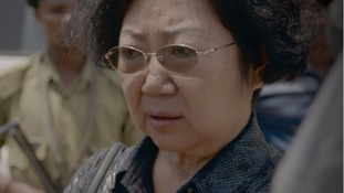 Yang Feng Glan leaves the Kisutu Resident Magistrate's Court yesterday after she was charged with smuggling ivory worth £1.62 million.