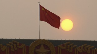 The national flag flies from the top of the National Museum of China.