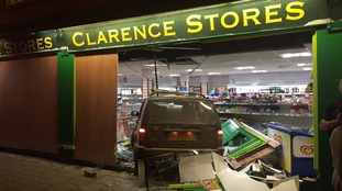 Car crashes into shop