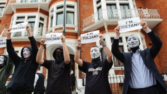 Masked supporters of Julian Assange outside the Embassy of Ecuador in Knightsbridge.